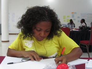Transcribing a practice interview, oral testimony workshop, Mozambique